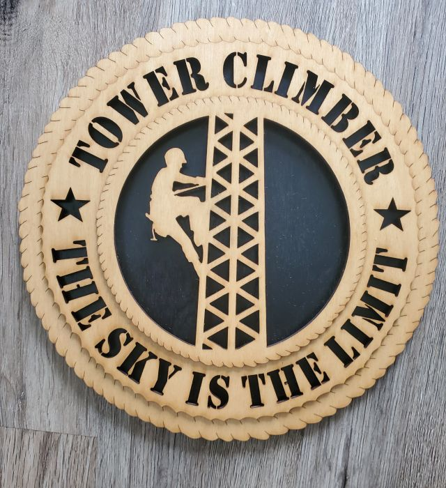 "Tower Climber Wall Art Plaque: 12"" in diameter. The Sky is the Limit"