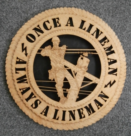 This gift for power linemen measures 11 inches in diameter and is made of laser-cut birch wood. Beautifully designed with the electric lineman in mind. Order this fine gift today!