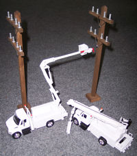 Add some accessories to your truck display with our power poles and pine trees!